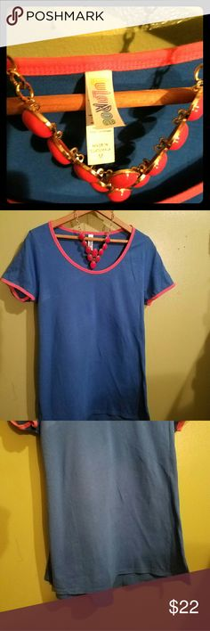 Lularoe Classic T Blue with Pink trim around collar and arms. Warn once, just a little too big for me. Super comfy. Washed per LULAROE guidelines. Lularoe  Tops Tees - Short Sleeve