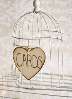 Cute idea to put cards in bird cage... maybe an old bird cage from garage sale painted teal/turquoise
