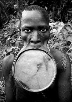 Surma woman with giant lip plate - Kibish Ethiopia by Eric Lafforgue