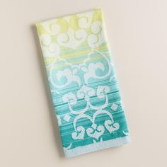 Add some elegant ombre to your kitchen decor with our jacquard towel, featuring an oversized damask pattern over cool blues and greens.