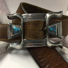 Vintage Navajo buckle with Bisbee turquoise on vintage leather strap