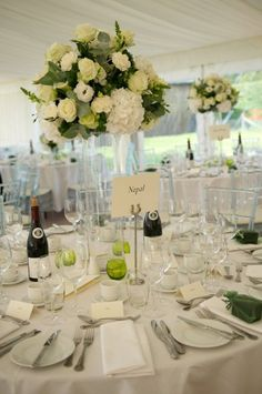 tall green and white cylinder vase table centres