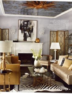 So in a past issue of InStyle magazine, there was an article about Joel McHale's house. This is his fabulous living room, apparently his wife is a chic interior designer. Who knew? High points for me- wallpapered ceiling, zebra rug.