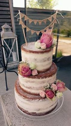 Vintage half naked cake with roses and topper designed by Zuckerzirkus Austria