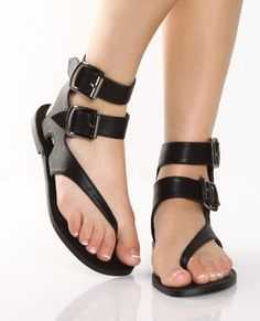 "Mykonos, Santorini, Rhodes or Crete, go island hopping in style with the GoMax Grecian 01 Black Double Strap Gladiator Thongs. These vegan leather sandals sport a diagonal toe thong strap and then wrap around your ankle with two inch wide straps and adjustable silver buckles. Flat heel is 1/4"" on a non skid flex-sole. Fit is true to size."
