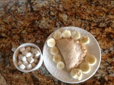 Swiss Hot Chocolate with marshmallows and  An apple cinnamon empanada with bananas on the side