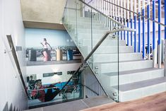 This frameless glass balustrade was designed and installed on a staircase by using stainless steel side-fix components. All of Steel Studio's frameless glass balustrade systems are tested for human impact and ensure the safety of those utilising a building.