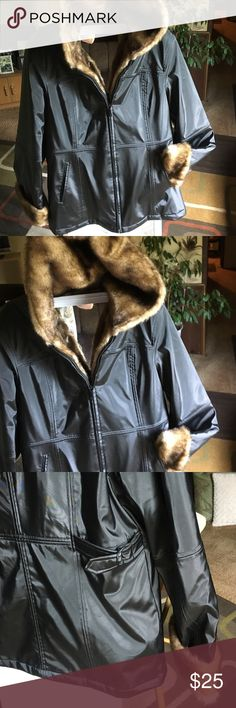 White Stag jacket 🍁 Black jacket with faux fur trim and hood🍁 material is shell: face 100% polyvinylchloride back 100% polyester imitation fur: face 100% acrylic back 100% polyester lining 100% polyester filling 100% polyester🍁 Jacket has adjustable side buckles at waist🍁2 front  slip pockets🍁 White Stag Jackets & Coats