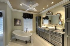 Classic bathroom with freestanding claw-foot tub and vessel sinks