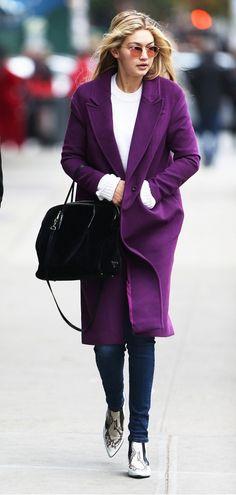 Gigi Hadid braves the cold in a vibrant purple coat.