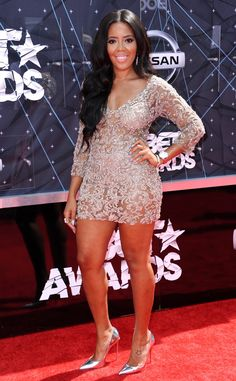 Hot Mess! Angela Simmons from 2015 BET Awards: Red Carpet Arrivals  The style maven steps out for the BET Awards in a glimmering, semi-sheer mini, which she offsets with silver pumps.