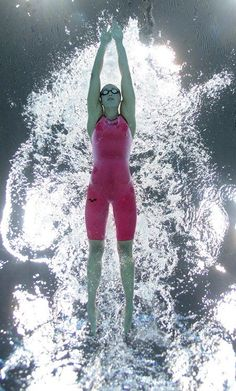 Rebecca Soni of the U.S. swims to a gold medal and new world record in the women's 200-meter breaststroke final. (Newsweek)