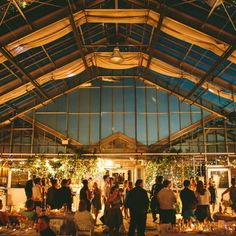 The reception was held inside the conservatory at the MSU Horticultural Gardens. Bistro lighting and candlelight cast romantic glow over the dramatic space as the sun set.
