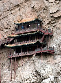 Xuan Kong Si Hanging Temple in China - Also known as the Suspension Temple, this unique monument was built into a cliff by monks near Mount Heng, near Datong, more than 1,500 years ago.
