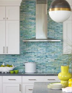 coastal chic kitchen. backsplash! I would totally do this sort of backsplash with more traditional door pulls and butcher block countertops, for a more rustic coastal cottage look.