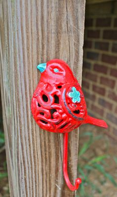Bird Wall Hook /Red /Turquoise accent /Chic Whimsy Decor /Key Holder /Bathroom Towel Rack /Nursery /Laundry /Mud Room /Distressed Iron Fix. $14.99, via Etsy.
