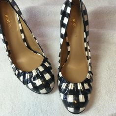 Nine West Heels This pair of Mine West Heels are so cute.  Black and white plaid  as you can see in the picture the inside and out is in excellent condition. The soles have a all amount of wear   They are a size 6 Nine West Shoes Heels