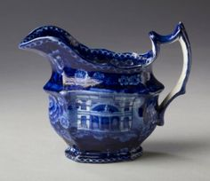 Northeast Auctions Annual Summer Americana Auction, August 2-3, 2014  Lot # 404.   'BALTIMORE MASONIC HALL,' STAFFORDSHIRE DARK BLUE TRANSFER-PRINTED CREAM JUG, UNKNOWN MAKER, CIRCA 1820. Est. $600-$800.  Sold: 3,840.  Description: Height 5 ½ inches.The Masonic Hall in Baltimore, Maryland was built to accommodate all the Masonic lodges which held meetings in the city. It was built between the years 1813-1822, and located at the corner of St Paul's Street and Courthouse Lane. It was razed in…