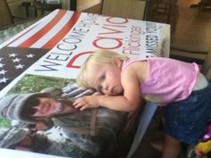 I received a welcome home banner in the mail (2 months before my husband's return from deployment), laid it out on the table, stood our 18 month old up on a chair... she took one look at him and put her head right on his chest.  She misses her Daddy!! <3