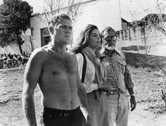 1972– Steve McQueen, Ali MacGraw and Sam Peckinpah on the set of The Getaway. — Image by © Sunset Boulevard/Corbis