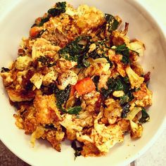 This scramble is loaded with veggies & protein. Easy to prepare but does  not skimp out on flavor! This is a great dish for weekend brunch or when  you are in the mood to have breakfast for dinner because it is super  satisfying!  Ingredients: Serves 1 & takes less than 30 minutes!  2 eggs 1 egg white 1/2 white onion 1/2 cup diced carrots 1/2 cup diced cauliflower  1-2 cups kale (torn in bit sized pieces)  2 tbsp. coconut oil 1/2 tsp. turmeric 1/4 tsp. ginger 1/2 tsp. cumin  1/2 tsp. chili…