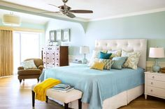 Wainscoting, moldings, and a soothing color scheme add character to a bland bedroom | Photo: Jill Connors