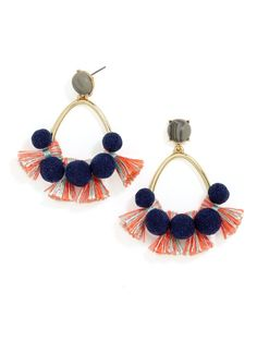 Threaded tufts and navy pom poms fringe a luxe gold hoop. Pair with like colors and flowy layers.