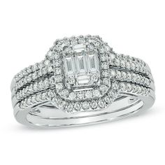 Fashioned in 14K white gold, the engagement ring features a cluster of round and baguette-cut diamonds at its center.