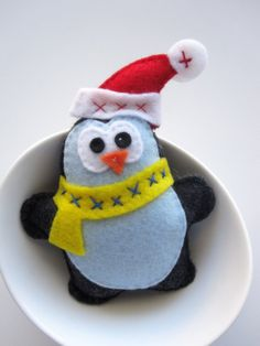Chri one is for you @Stephanie Clearystmas ornament, Felt Penguin Ornament for @Louisa SteylThis