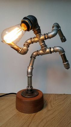 Iron pipe lamp  The Running Man by PureIron on Etsy