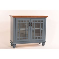 Breakwater Bay Eberton Vintage TV Stand Finish: Tempting Turquoise/Concord Cherry