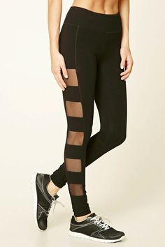 A pair of knit cotton-blend leggings featuring caged mesh paneling down the sides and an elasticized waist.