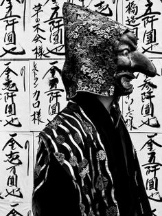 Menkake Gyoretsu - Procession of people wearing grotesque masks from the Goryo Shrine to Gokurakuji Temple, Kamakura, Kanagawa, Japan - Based on a legend that Yoritomo had affair with an outcast girl whom he visited accompanied by masked men to hide his identity. The masks are antique pieces from the mid 18th c. Sept. 2012. S)