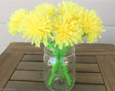 Make an easy DIY dandelion bouquest with yarn and pipe cleaners to delight someone you love. Perfect for weddings, parties and Mother's Day.