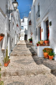Streets of Frigiliana, Málaga, Spain.  The city is fill of stairs; they go for miles; shops, pubs, houses intermingled with houses