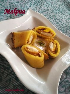 Share this on WhatsAppHow to make Malpua Recipe/Malpua Stuffed With Kalakand Recipe with step by step pictures. Hi Foodies! Today I am sharing new and luscious version of malpua with you. Mapluas are crisp fried and fluffy pancakes dipped in sugar syrup, served with rabdi and dryfruits topping. You must surely try this new and delicious style. Inspite of giving topping of rabdi to the sweet pancakes, I have stuffed