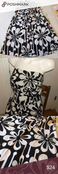 Torrid Black White Floral Strapless Sundress 12 This is a sundress by Torrid in a size 12 Cotton spandex fabric Zipper in back and elastic in back edge Loosely Ruched front on bodice A line skirt Black with white large floral print In very good used condition torrid Dresses Mini