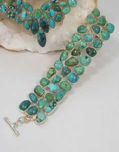 Handmade Tibetan Turquoise bracelet featuring 36 free-form cabachon polished gemstones with natural organic markings, set in 925-hallmarked sterling silver. Matching necklace available separately. Len