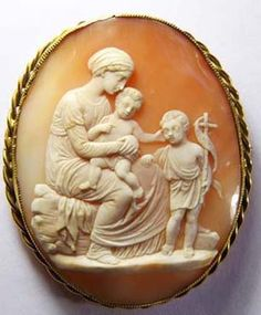 This is a MUSEUM CARVED QUALITY CAMEO OF MARY,JESUS AND JOHN,The setting is 9 ct gold not marked but tested.The size is  2 by 2 1/4 has the c and t pin and a safety chain.Much nicer in person. There are some natural lines in left hand corner. From around 1880.