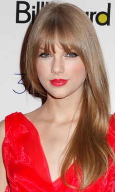 Taylor Swift Breaks Away From Her Natural Curly Hairstyle With Straight Hair And A Fringe, 2011