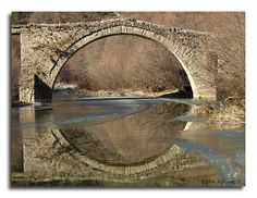 stone bridge and reflection