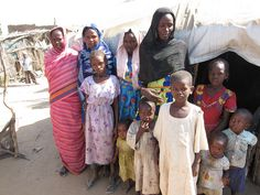 A family at their home in Goz Amer, a refugee camp for people from Darfur.