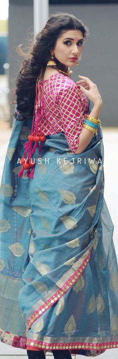 Cotton silk saree and blouse by Ayush Kejriwal. Pretty jhumkis.  For purchase enquires email me at ayushk@hotmail.co.uk or whats app me on 00447840384707. We ship WORLDWIDE.