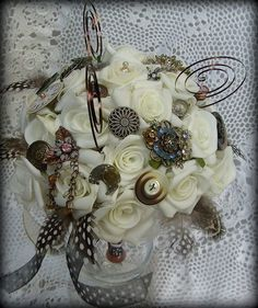 Pretty and detailed bouquet made with Ivory faux roses and vintage watch parts. Buttons, beads, brooches and ribbon. Watch springs complete the bouquet. A gorgeous matching buttonhole is included set in a tarnished metal holder. Diy Bouquet, Brooch Bouquets, Vintage Pins, Vintage Buttons, Steampunk Wedding Cake, Victorian Wedding Themes, Foam Roses, Our Wedding, Wedding Stuff