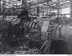Hamburg, Germany. 1945-05-05. U-boats, nearing completion, lie in wreckage at the Blohm and Voss yards, the result of a Bomber Command raid.