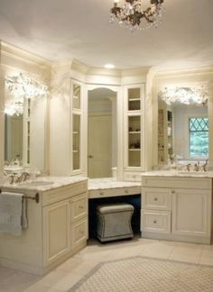 all white bathroom with his and hers sink and makeup station