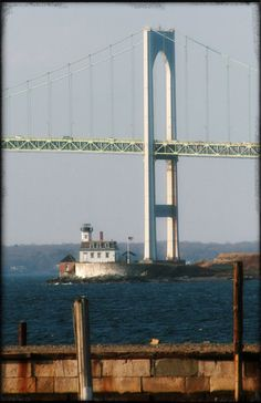 photograph Rose IslanNewpord Lighthouse Newport RI with a good picture of the Newport Bridge