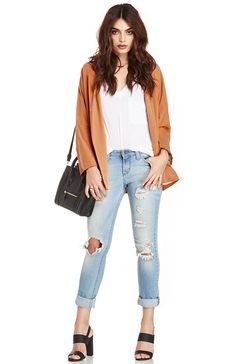Everyone at the DL Headquarters is obsessed with this rust colored boyfriend blazer. It's a luxurious piece that goes perfect with a simply white tee and a pair of distressed denim. Effortlessly chic!