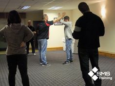 Students learning the Physical Intervention Module of their Door Supervision Course at the Cardiff Arms Park, if you are interested in a Physical Intervention, Door Supervisor or Upskilling for Door Supervisors check out our website for latest course dates, venues and prices!  http://www.syracusemanagedsolutions.net/sia-security-training#.Ut1DexDFKM8 — at Cardiff Arms Park