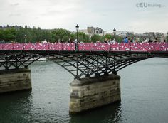 These pink panels, which are different to the other side, were created by the street artist El Seed with a quote in Arabic by the poet Honore de Balzac.  See more www.eutouring.com/images_pont_des_arts_2015.html